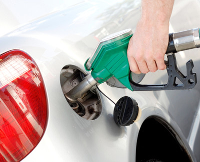 Man Dispensing Petrol into Car