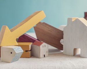 Wooden Block House Price Crash Concept