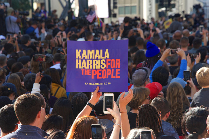 Kamala Harris Supporter Holding Sign at Rally