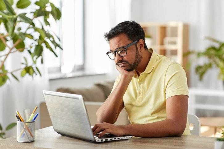 Man Bored on Laptop