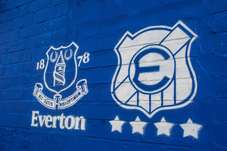 Everton Logo on Blue Wall