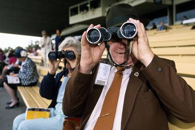 Man Watching Horse Racing