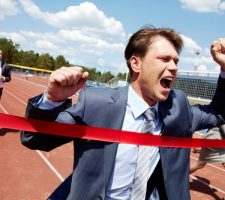 Business Man Crossing Finishing Line