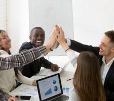 Team Celebrating Positve Company Results