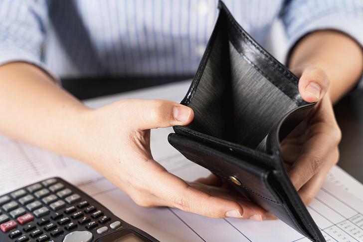 Woman Looking in Empty Wallet