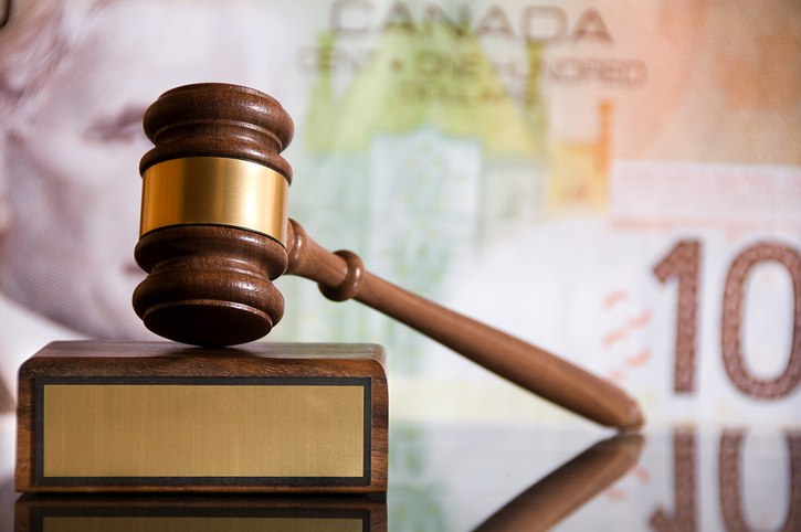 Gavel and Canadian Currency