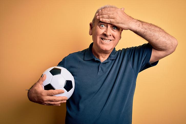 Stressed Man Holding Football