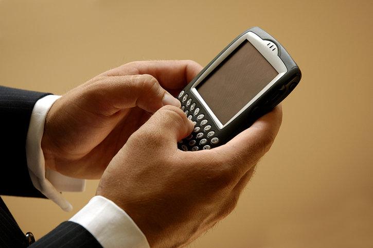 Man Sending Text Message